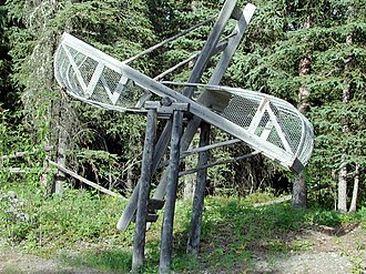 Fish wheel - A wooden fish wheel out of the water.