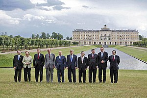 32nd G8 summit - G8 leaders standing outside the Constantine Palace. Left to right: Romano Prodi, Angela Merkel, Tony Blair, Jacques Chirac, Vladimir Putin, George W. Bush, Junichiro Koizumi, Stephen Harper, Matti Vanhanen and José Manuel Barroso.