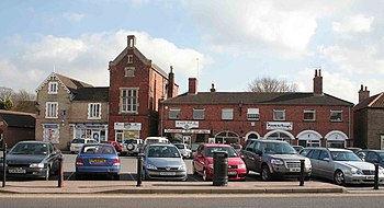 English: Wragby Market place and car park Pets...