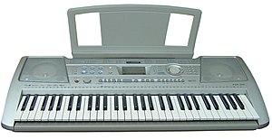 English: Yamaha electronic keyboard Français :...