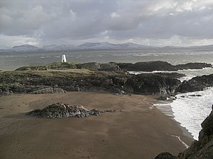 Ynys Llanddwyn -  Tŵr Bach lighthouse with Snowdonia in background