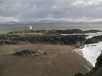 North Wales - Llanddwyn Island's old lighthouse, with Snowdonia in background