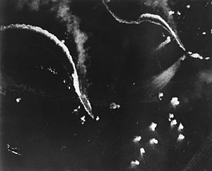 The Japanese aircraft carriers Zuikaku, left, and (probably) Zuihō come under attack by dive bombers early in the battle off Cape Engaño.