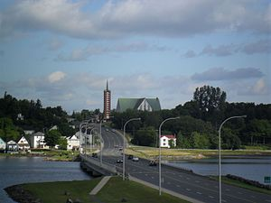 Bathurst, New Brunswick - Looking north at Bathurst waterfront, with Holy Family church in background.