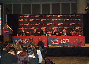 Grant Morrison - Morrison, fourth from left, at the Legendary Comics panel at the 2012 New York Comic Con. Sharing the stage with him from left to right: Bob Schreck, Matt Wagner, Guillermo del Toro and Travis Beacham.