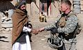 100301-A2095R-005- PAKTYA PROVINCE, Afghanistan - U.S. Army Maj. Christian Jenni of Orem, Utah, Alpha Company commander with the 405th Civil Affairs Battalion from Pleasant Grove, Utah, greets a local resident 100301-A-OQ227-005.jpg