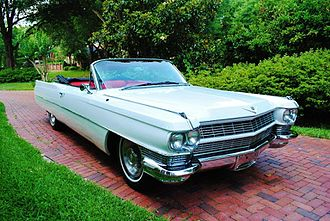 The Sucker - 1964 white Cadillac DeVille convertible