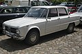 1968 Alfa Romeo Giulia 1300TI berlina in white, front left.jpg