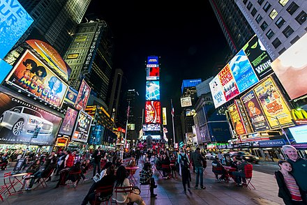 Times Square in Midtown Manhattan, hub of the Broadway theater district, a media center, and one of the world's busiest pedestrian intersections 1 times square night 2013.jpg