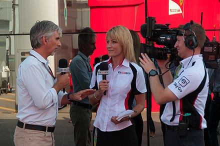 Hill (left) working as a presenter for Sky Sports F1 2012 Italian GP - Damon Hill.jpg