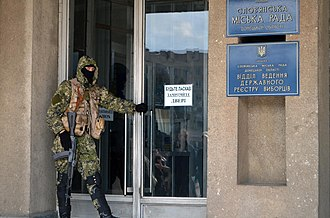 Siege of Sloviansk - Armed militiamen occupying the council building on April 14.