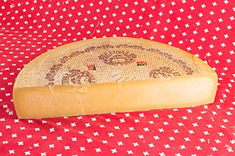 Appellation d'origine protégée (Switzerland) - In 2000, the cheese L'Etivaz was the first Swiss product other than wine to obtain an appellation d'origine contrôlée. In 2013, the certification was replaced by the appellation d'origine protégée (AOP). The AOP logo is visible on the rind.