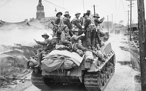 Australian troops riding on a US Army Sherman tank at Sariwon in October 1950