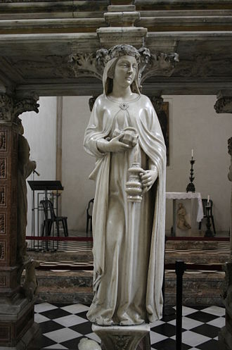 Temperance (Tarot card) - A woman mixing water into wine was a standard allegory of Temperance in European iconography.  This statue is part of Peter of Verona's tomb.