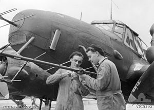No. 67 Squadron RAAF - Ground crew adjust a No. 67 Squadron Avro Anson's radar in 1945