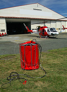 Helicopter bucket specialised bucket suspended on a cable carried by a helicopter to deliver water for aerial firefighting