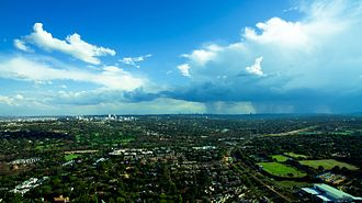 An aerial photograph of summer rain clouds over Johannesburg. The city's climate experiences regular daily thunderstorms from November to March in the afternoons. A Johannesburg Summers Day.jpg