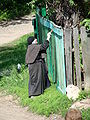 A Nun Paints a Fence - Suzdal - Russia.JPG