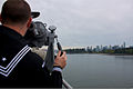 A U.S. Sailor aboard the guided missile cruiser USS Lake Champlain (CG 57) scans the water for contacts in front of the ship as the Lake Champlain makes its way into port during Trident Fury 2013 in Vancouver 130426-N-ZZ999-014.jpg