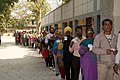 A long queue of voters to cast their votes for the Delhi Assembly Election, in New Delhi on February 07, 2015 (1).jpg