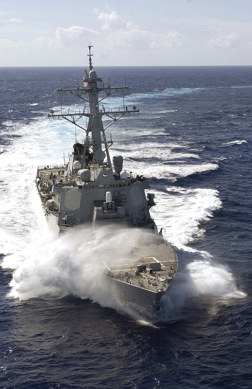 A wave breaks over the bow of the destroyer USS Russell (DDG 59) as it plows through the South Pacific Ocean on 070209-N-HX866-007