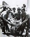 A wounded crewmen of USS Liberty (AGTR-5) is carried on the flight deck of USS America (CVA-66), 9 June 1967.jpg