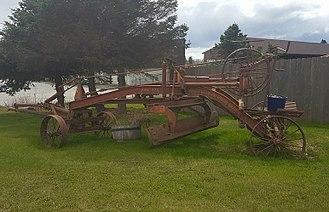 Grader - Antique Adams leaning wheel road grader on display outside of Homer Public Works building, Homer, Alaska