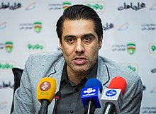 Afshin Peyrovani in press conference with New Iranian Federation President.jpg