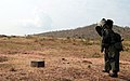 An explosive ordinance disposal soldier with 1st Sapper Company, Burundi National Defense Force, approaches a simulated improvised explosive device during a combined arms breaching exercise, June 26, 2012.jpg