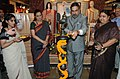 Anand Sharma lighting the lamp to inaugurate the Exhibition of Handicraft and Handloom Products from West Bengal, in New Delhi. The Minister of State for Textiles, Smt. Panabaka Lakshmi and the Secretary.jpg