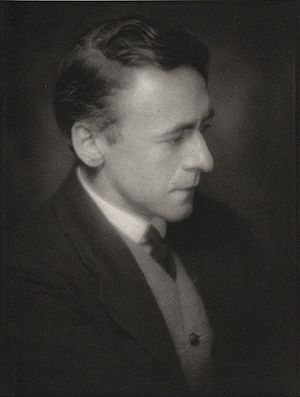 profile head and shoulders of clean-shaven man in middle age