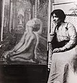 Artist da Loria Norman seated with painting, c. 1929.jpg