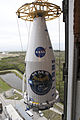 Atlas V payload fairing carrying MMS raised at Launch Complex 41 (KSC-2015-1538).jpg