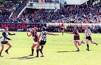 Mark (Australian rules football) - A player in a marking contest attempts a one handed chest mark