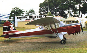 Auster Autocrat - Auster J/1N Alpha in British Eagle colours at Casey Airfield, Berwick, Victoria, Australia in 1988