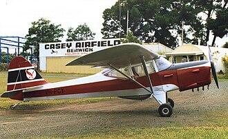 Auster Autocrat - Auster J/1N Alpha in British Eagle colours at Casey Airfield, Berwick, Victoria, Australia in 1988