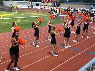 Baker University - Baker pep squad leading cheers at a game