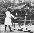 Banjo Paterson's children Grace and Hugh boxing with Christmas present gloves, Sydney, NSW, 1919 - photographer unknown (12579204974).jpg