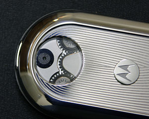 Motorola Aura - Close-up of swivel mechanism gears, visible through clear back window.