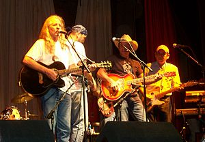 Bob Childers - Bob Childers on stage with the Red Dirt Rangers (John Cooper, Brad Piccolo, Ben Han)  at the Woody Guthrie Folk Festival July 11, 2007