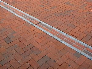Freedom Trail path on a red brick sidewalk in ...