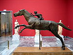 Bronze statue of a horse and young jockey.jpg