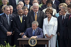 President George W. Bush signs the reauthoriza...