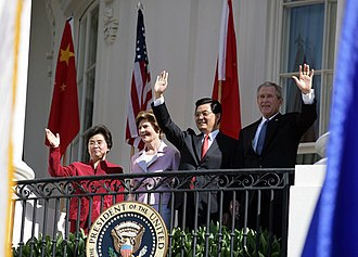 Politics of China - Hu Jintao and US president George W. Bush, with first ladies Liu Yongqing and Laura Bush, wave from the White House. The relationship between the world's sole superpower United States and the emerging superpower status of the PRC is closely watched by international observers.