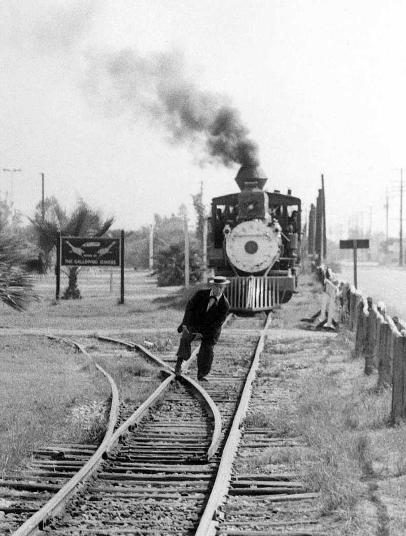 Buster Keaton feigning his foot stuck in the railroad tracks