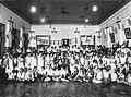 COLLECTIE TROPENMUSEUM Groepsportret met de schoolleerlingen van de Carpentier Alting Stichting (CAS) tijdens een feest TMnr 60027529.jpg