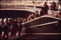 COMMUTERS AT THE STATEN ISLAND FERRY TERMINAL IN LOWER MANHATTAN'S BATTERY PARK AREA - NARA - 549904.tif