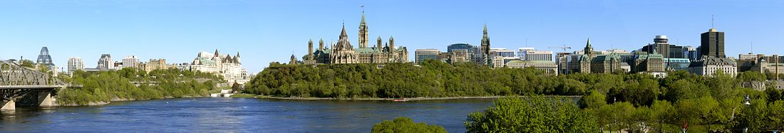 Ottawa above the Ottawa River in May, left to right— Alexandra Bridge · National Gallery of Canada · Byward Market · Fairmont Château Laurier · Rideau Canal Locks · Parliament Hill with Library of Parliament and Peace Tower · Downtown Ottawa towers · Supreme Court of Canada