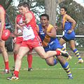 Canadian aussie rules player kicks.jpg
