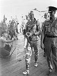 Carpenter on board USS Intrepid.jpg